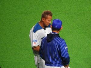 中田と坪井コーチ。