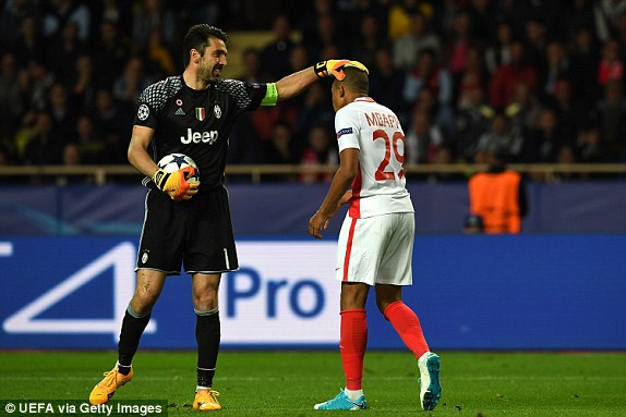 Gianluigi Buffon of Juventus consoles Kylian Mbappe of Monaco after the striker misses a chance
