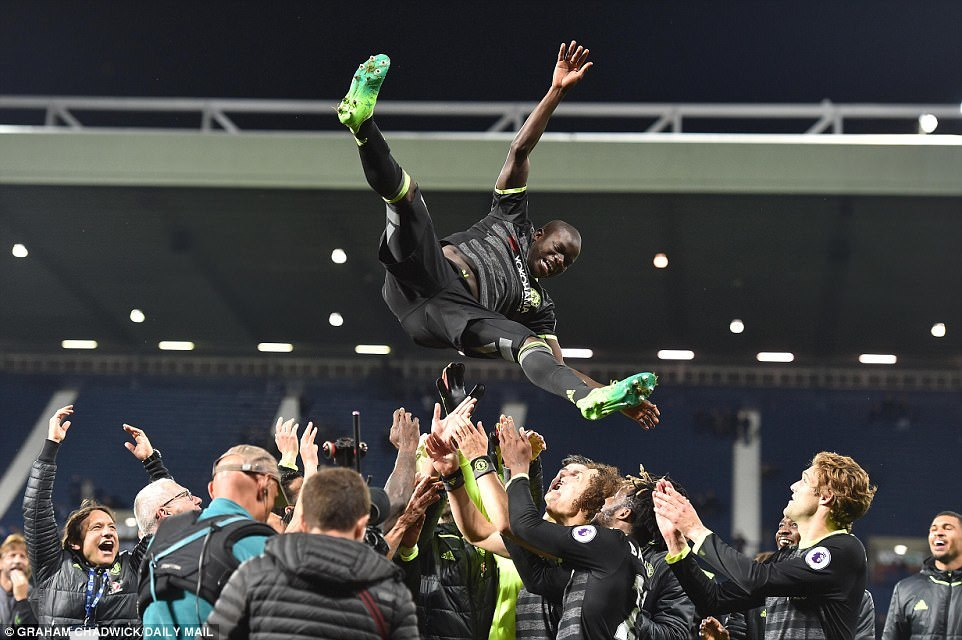 Chelsea player of the season NGolo Kante is hurled into the night air by his team-mates