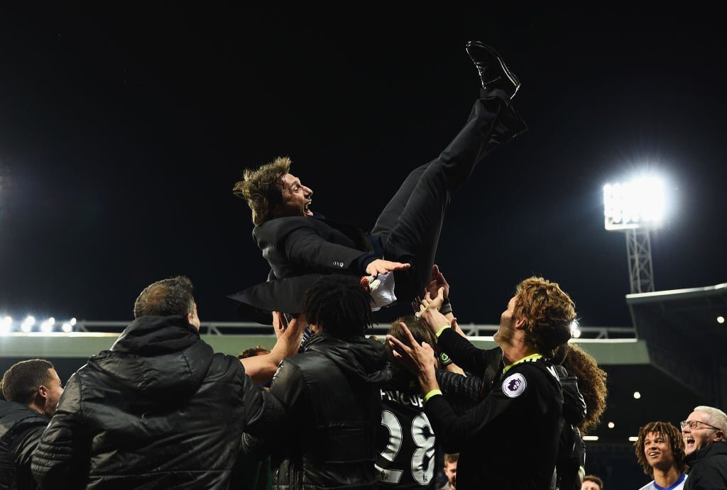 Chelsea players throw boss Antonio Conte into the air following their last gasp heroics in the Midlands