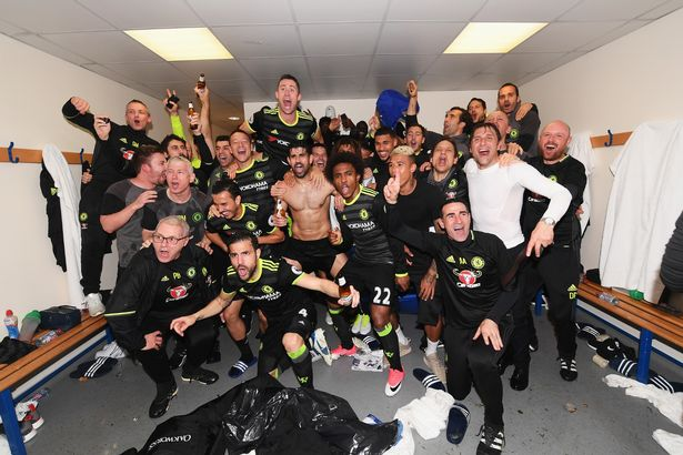 Conte joins the squad after being soaked with champagne