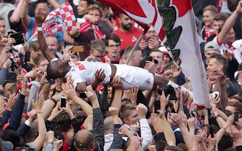 Koln fans after securing European football for the first time in 25 years, amongst them is top goalscorer Anthony Modeste crowd surfing