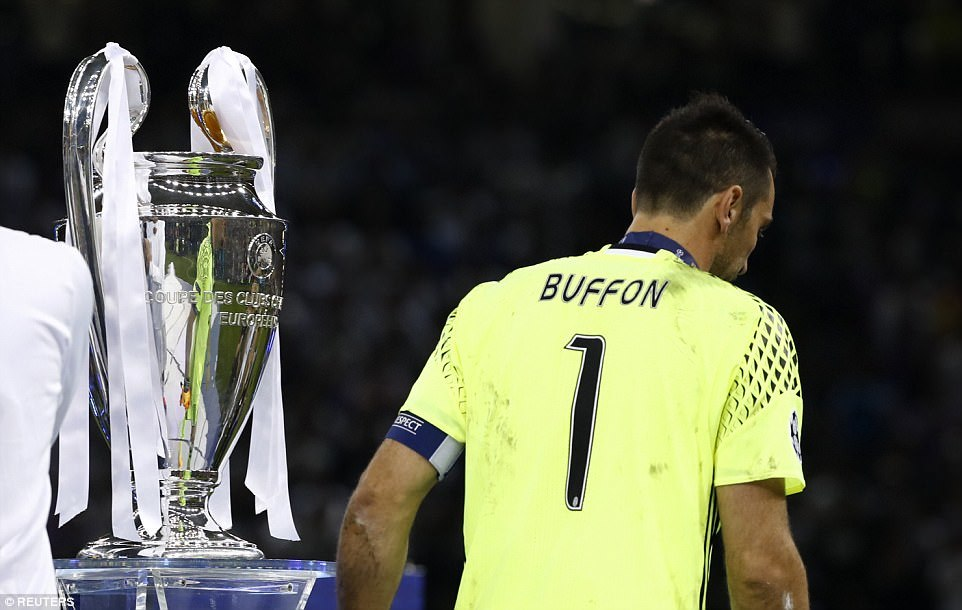Gianluigi Buffon walks past the trophy after collecting his runners up medal - the Champions League continues to allude him