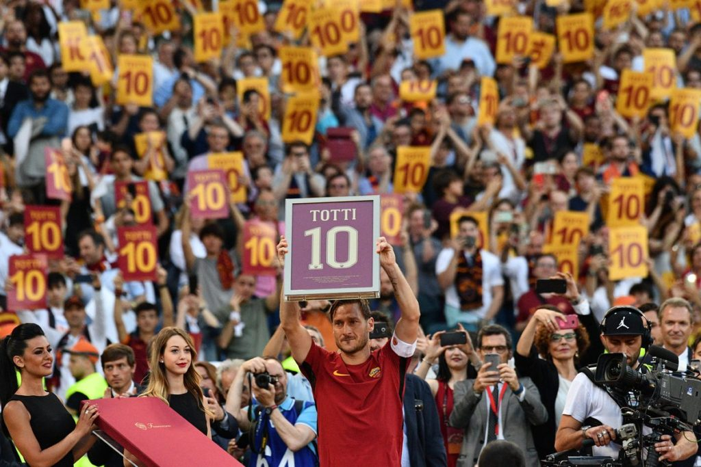 Francesco Totti was in tears after the game as he received a framed number 10