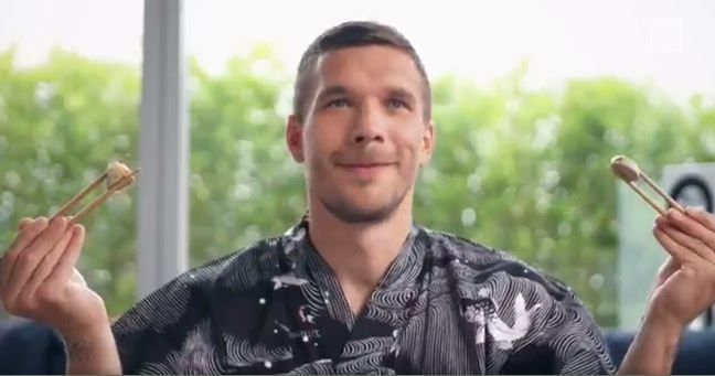Lukas Podolski adapts to life in Japan by eating bratwurst with chopsticks