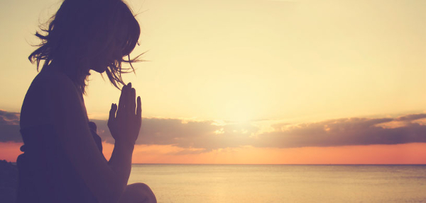 woman-in-meditating-at-sunset600.jpg