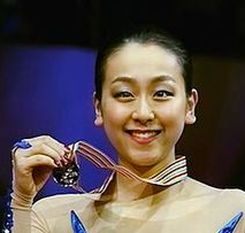 Mao_Asada_Podium_2014_World_Championships.jpg